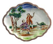A CHINESE EXPORT SCALLOPED OVAL STAND