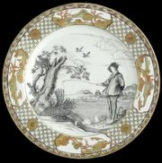 A CHINESE EXPORT 'LE PÊCHEUR' PLATE