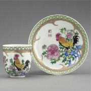 A CHINESE EXPORT FAMILLE-ROSE COFFEE CUP AND SAUCER