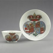 CHINESE EXPORT ARMORIAL TEABOWL AND SAUCER