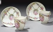 A PAIR OF 18TH CENTURY CONTINENTAL SOFT-PASTE PORCELAIN CUPS AND SAUCERS