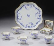 AN 18TH CENTURY SEVRES SOFT-PASTE PORCELAIN SHAPED TRAY AND FIVE CUPS