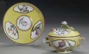 AN 18TH CENTURY MEISSEN PORCELAIN YELLOW-GROUND ECUELLE, STAND AND A COVER