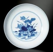 A BLUE AND WHITE 'LOTUS POND' SAUCER DISH