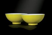 A PAIR OF LEMON-YELLOW-ENAMELLED BOWLS