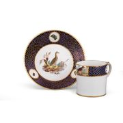 A TOURNAI CAN AND SAUCER FROM THE DUC D'ORL?ANS SERVICE, CIRCA 1787