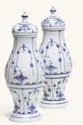 A PAIR OF RAUENSTEIN REEDED BALUSTER BLUE AND WHITE VASES AND COVERS