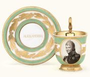 A BERLIN GREEN-GROUND IMPERIAL PORTRAIT CABINET-CUP AND SAUCER